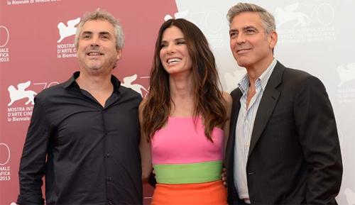 Alfonso Cuarón, Sandra Bullock i George Clooney a la presentació de 'Gravity' a Venecia